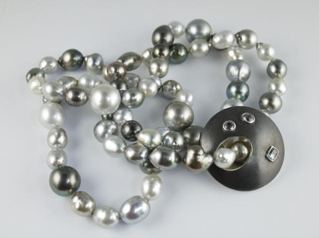 Pearls with silver and sapphire disc