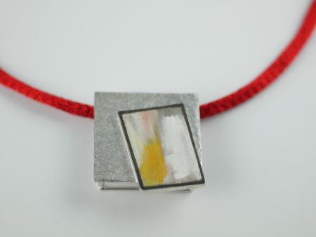 Yellow painted pendant in Stg Silver on Titanium