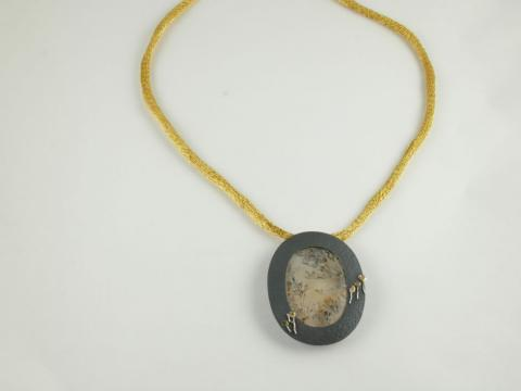 Dendritic Quartz pendant framed by oxidized Silver with Gold details