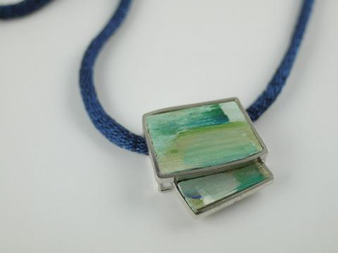 BlueGreen Painted pendant set in Stg Silver on Titanium