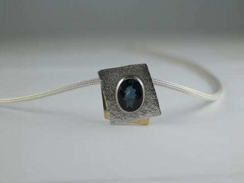 Blue Topaz in 18ct Gold and Sterling Silver frame-Silver cable