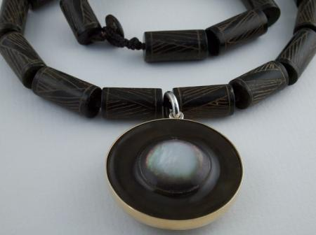 Carved Mother of Pearl set in Gold and Silver on engraved beads