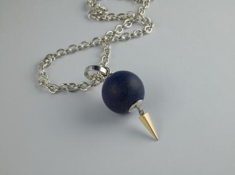 Lapis lazuli bead hollowed out to hold a poem or memento with gold spike
