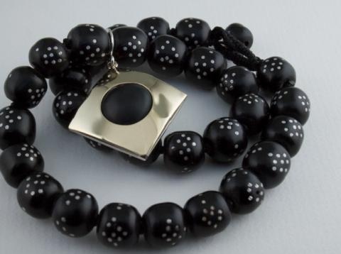 Australian Black Jade set in Gold and Silver suspended from inlayed beads