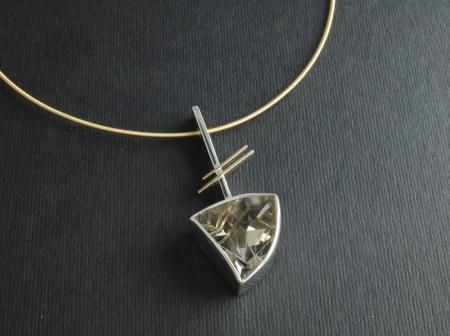 Golden rutilated Quartz lazer cut in silver and gold