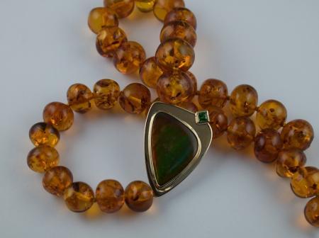 Ammolite and Amber set in gold with Tzavorite Garnet