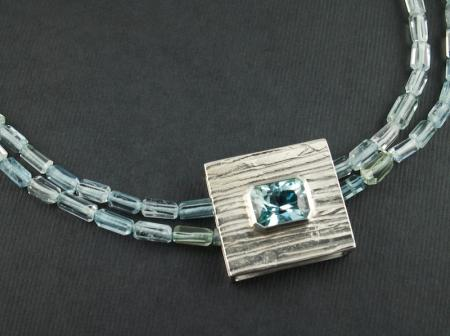 Russian blue Topaz 8.5cts set in silver with Aquamarine beads