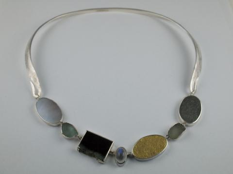 Found pebbles,jade, moonstone and gold set in silver forged Necklace