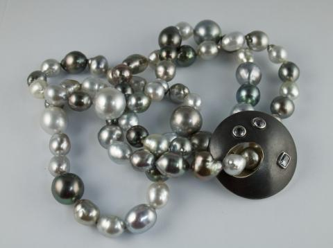 Pearls with silver disc set with  Sapphires