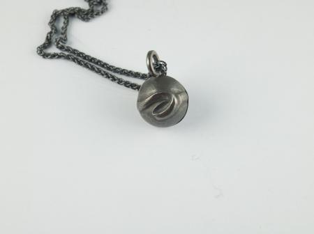 Sterling silver, repousse and oxidized