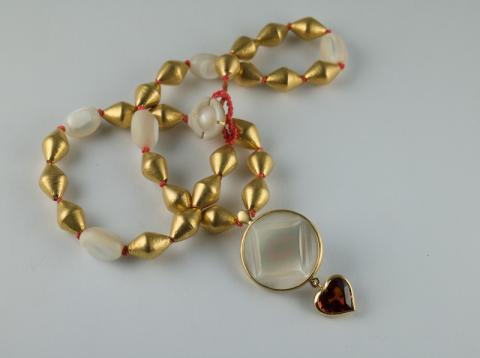Carved mother of Pearl and 22ct beads with Spessartite garnet heart