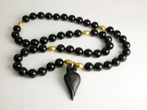 Rosebud carved in Jet with 22 carat gold beads as spacers in the jet beads