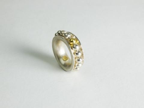 Sterling silver ring with moving beads and 1 gold bead as the counter.