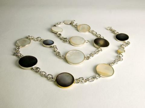 Mother of pearl 13 moons in a year set in silver on silver chain