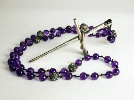 "Amethyst beads with Roses as the ""our Fathers"" holding a Silver Crucifix"