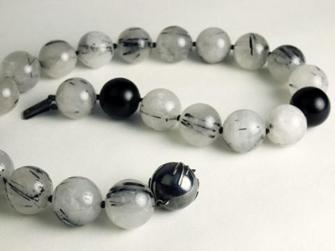 Beads and silver clasp which references the beads