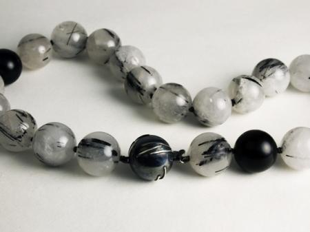 Quartz beads with Tourmaline inclusions and Silver clasp to reflect the beads.