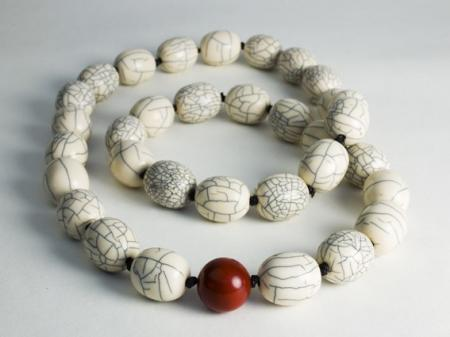 Oval bone beads and one Jasper bead.