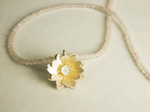 Sterling silver lotus with gold stamen on Rose Quartz beads.
