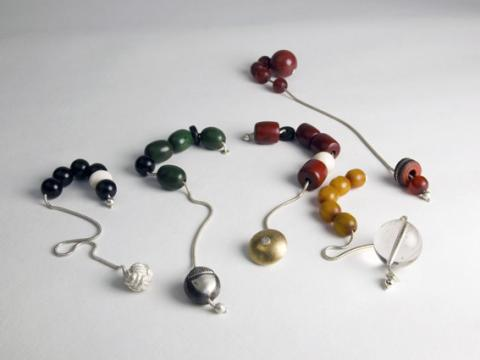 Playful contemporary hand Komboloi in  Copal, Amber & Silver