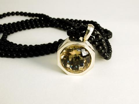 Smokey Quartz set in Sterling silver on Onyx beads