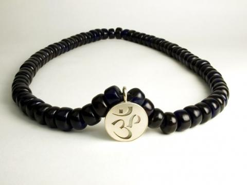 Sterling silver om backed by mother of pearl