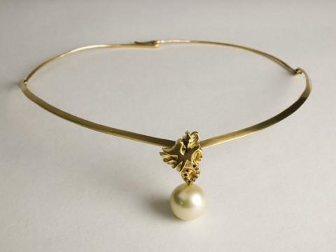 Carved dragon in 18ct gold set with Red Diamonds holding a Southseas Pearl
