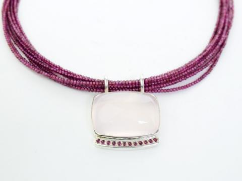 Cabachon Rose Quartz set in silver on Tourmaline beads