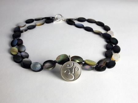 Mother of pearl necklace with Om the first sound of creation