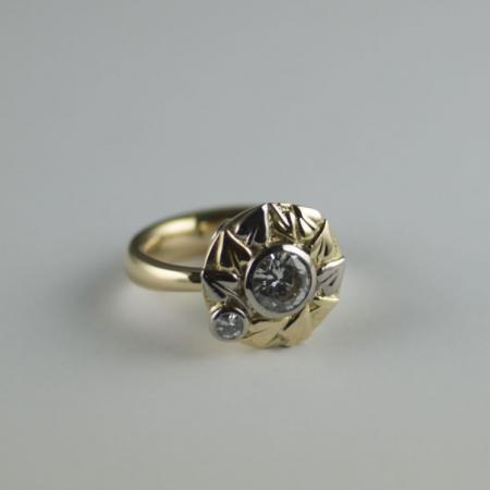 Diamond in 18ct yellow and white gold with bleeding heart leaves