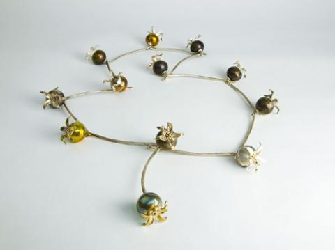 Sterling silver rosehips  threaded like the daisy chains we played with as children